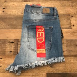 High rise stretchy distressed jean shorts
